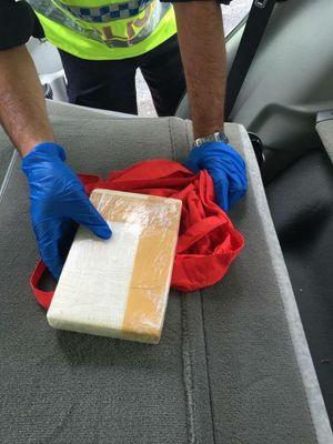Coffs Harbour police seized more than 1kg of cocaine after a vehicle stop on the Pacific Hwy.