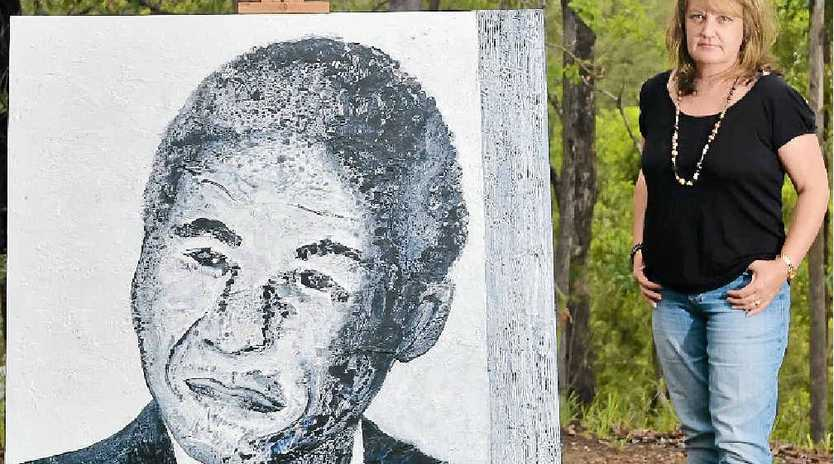 Landers Shoot artist Meloney Steyl with her portrait of Nelson Mandela, which will be hung in the South African High Commission in Canberra.