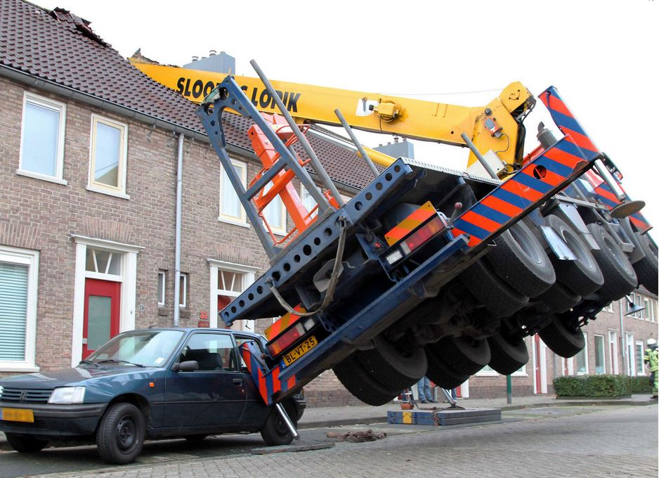 A general view of the crane which fell on to the roof of a house in IJsselstein, central Netherlands, 13 December 2014. The incident ocurred when a man tried to surprise his girlfriend by proposing from the top of the crane, which then toppled on to the house, though no injuries were reported.