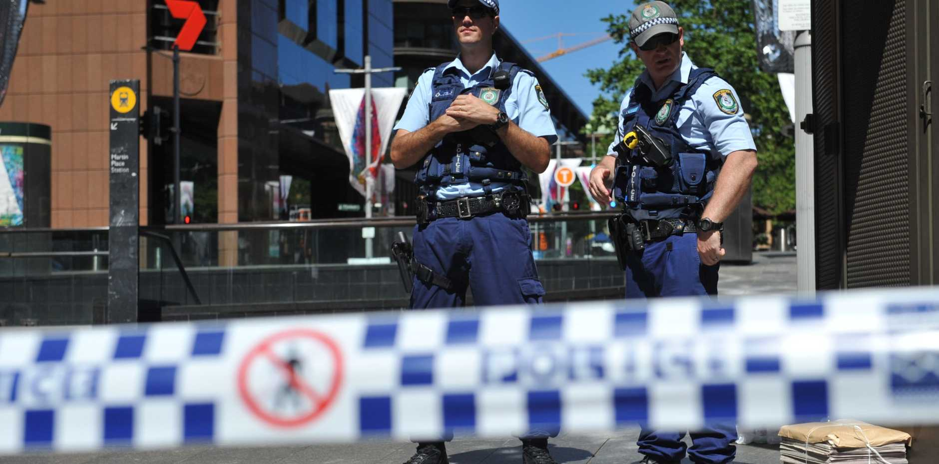 NSW Police are seen in Martin Place near the Lindt Cafe in the central business district of Sydney, Monday, Dec. 15, 2014.  (AAP Image/Joel Carrett)