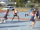 Larissa Millard in possession for the winning Assumption team in B-grade netball at Barnes Park.