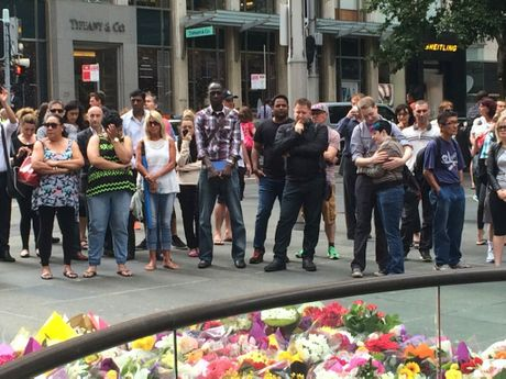 Sydney on lock-down in wake of terrorist siege at Martin Place in which two innocents and a gunman were killed on Monday, December 15, 2014. Mourners lay flowers to pay their respects. Photo Chris Calcino / APN NewsDesk