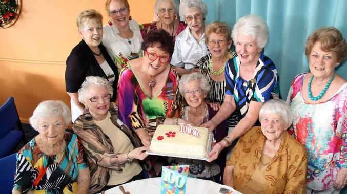 100 NOT OUT: Joyce Morton (behind the birthday cake) celebrates with her friends form the Bonville View Club.