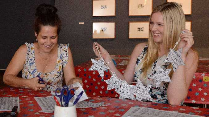 Artspace Mackay public programs officer Billie-jo Obst (left) and public programs assistant Khara Deurhof are on hand at the gallery to help families with Christmas craft activities.