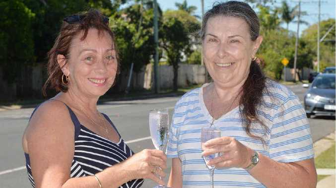 Juliet St residents Leonie Conlon (left) and Sandra Amoore toast the good news that, for the time being, a Mackay Regional Council realignment plan for Juliet St has been put on hold.