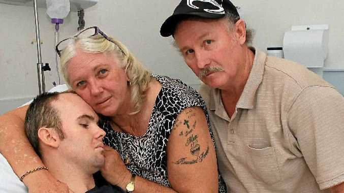 LEGAL FIGHT: Betty and Allan Barker with their son Chrys.