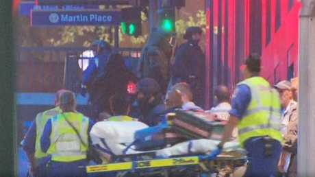 NSW Ambulance paramedics treating hostages of the Sydney siege. Photo contributed.