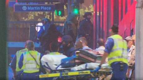 NSW Ambulance paramedics treating hostages of the Sydney siege. Photo contributed.