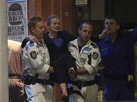 An injured hostage is carried to an ambulance. Photo: AP Rob Griffith