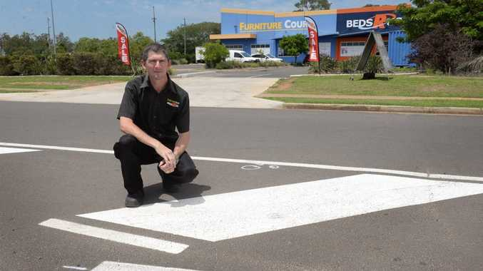 BEDS R US: Darren Scheuer feels that the new lines painted outside his Johanna Boulevard premises are a little too confusing for drivers trying to access the parking. Photo: Mike Knott / NewsMail