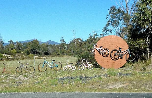 RIDING THE FENCE LINE: This pic, sent in by a Tasmanian driver, of bicycles along a Scamander fence.
