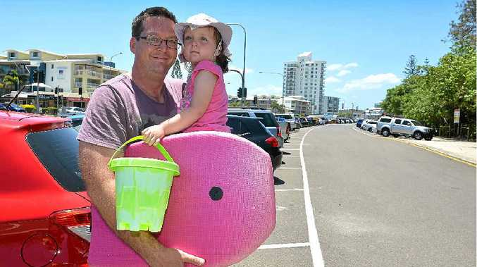 IT'S THE LIMIT: Sam Galer, pictured with his daughter Connie, says parking restrictions at the beach are unAustralian.
