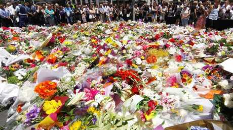 A sea of floral tributes is growing at Martin Place where two Australians -- Katrina Dawson and Tori Johnson -- were killed during a 17-hour siege.