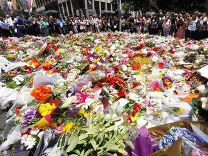 Sydney blooms under the shadow of siege deaths
