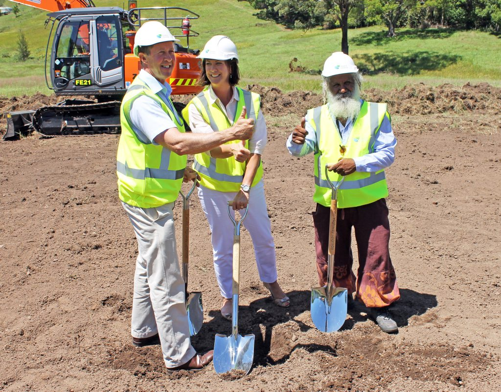FIRST SOD: Federal Member for Cowper Luke Hartsuyker, Nationals candidate for Oxley Melinda Pavey MLC and Nambucca Shire councillor Martin Ballangarry OAM give the thumbs up to the beginning of the Warrell Creek to Nambucca Heads Pacific Hwy upgrade project. Photo: Contributed