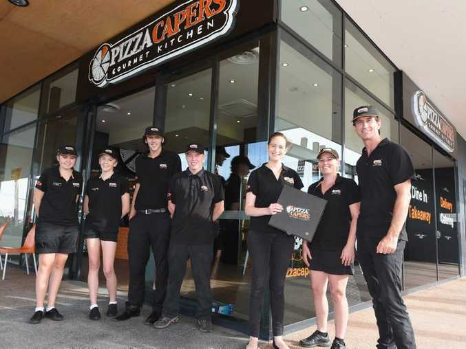 Jayde Alexander, Sophie McCosker, Kahn Phillips and Dyllan Cattell with Pizza Capers owners Katie Jackson, Mary Cattell and Craig Calcutt at Stockland Hervey Bay.