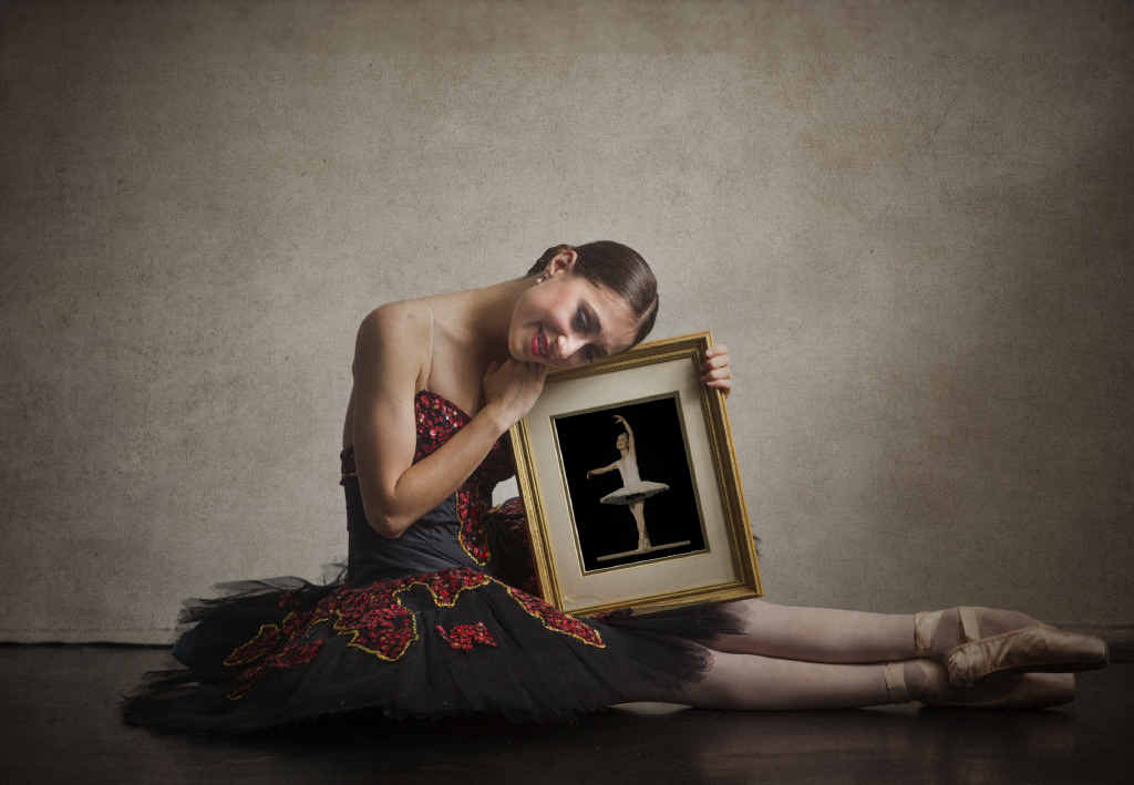 Lucy Ryder, 18, with a photo of one of her first dance performances reflects on her time with the Clarence River Dance Academy before starting full-time dance training next year with the National College of Dance. PHOTO: ADAM HOURIGAN
