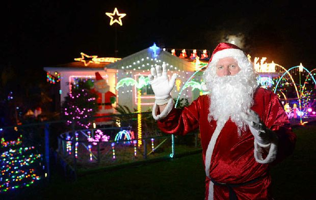 PEOPLE'S CHOICE: Santa and Gympie residents loved the Barton Rd display, above.TOP HOUSE: Emma Novak and her daughter loved the Sproule Rd lights belonging to Ray and Trish Doel.