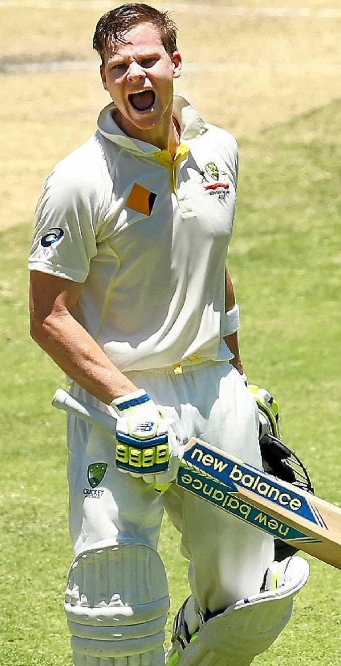 Australian captain Steve Smith celebrates scoring a century at the Gabba yesterday.