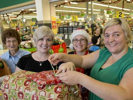 Volunteer gift wrappers (from left) Daph Parker, Ashleigh Sinclair, Penni Kretschmann and Anna Roeger raise money for Queensland Cancer Council.