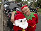 Santa and his elf Sharon Hine of Dalby before setting off on her Honda CBR 500 in the Downs Motorcycle Sporting Club hosted annual Toowoomba Toy Run, Sunday, December 21, 2014. Photo Kevin Farmer / The Chronicle