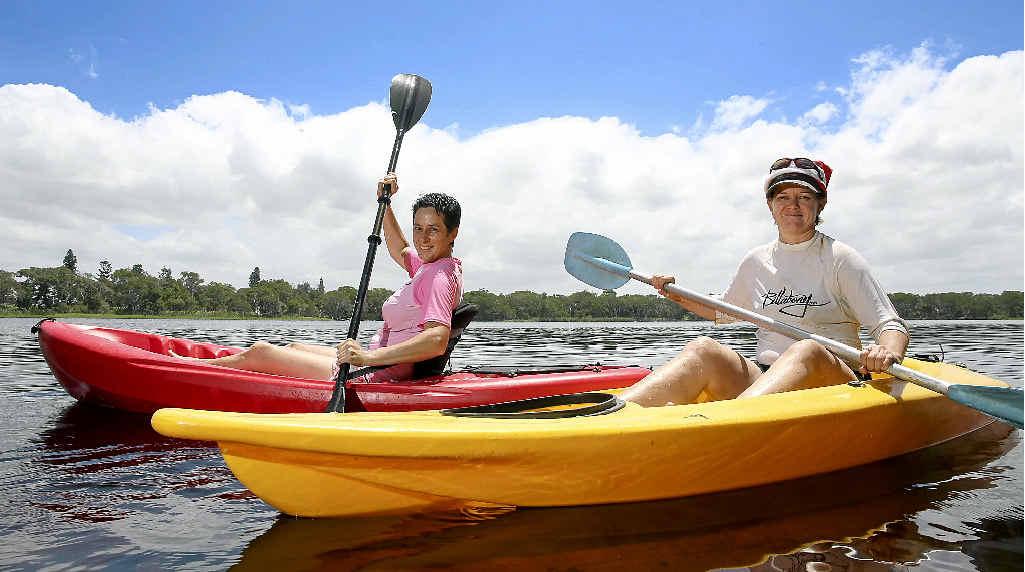 POPULAR: Liz Phillips and Linda Scott enjoying what Lake Ainsworth in Lennox Head has to offer.