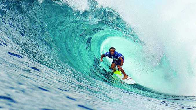 Coolum Beach's Julian Wilson gets great cover in the final of the Billabong Pipe Masters yesterday.