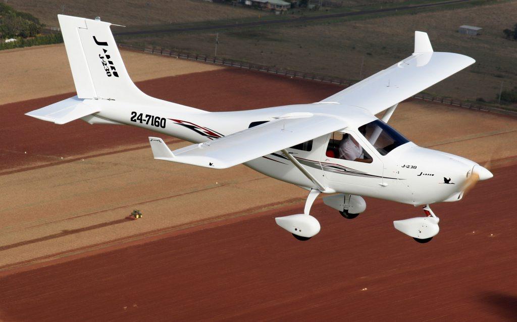 The Jabiru J230-D soars over crop paddocks in the Bundaberg region.