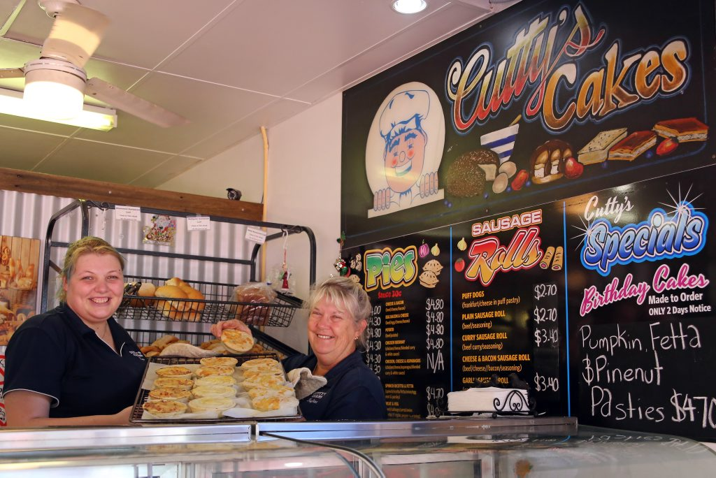 Amber Hutchins with Cutty's Cakes owner Kaylene Cutmore. Cutty's Cakes was voted as having the best pies in Coffs Harbour in an Advocate Facebook poll. Photo: Gemima Harvey/Coffs Coast Advocate