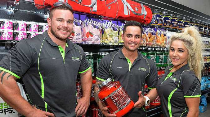 NOW OPEN: Stocking the shelves at Aussie Supps (from left) are Liam Tuohy, Tommy Montaperto and Jess Montaperto.