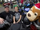 READY TO ROLL: Jamie (left) and Trent Woods and a toy Christmas dog are ready to join the annual charity toy run across Toowoomba yesterday.
