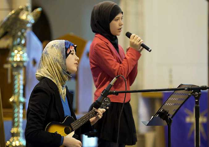 PROMOTING HARMONY: Sisters Jadzia (left) and Brittania Clifford-Pugh perform John Lennon's song Imagine.