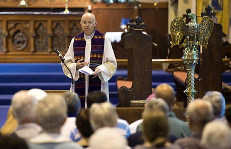Reverend Dr Jonathan Inkpin addresses the gathering at the Community Prayer for Peace service at St Luke's Anglican Church on Saturday.