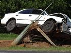 A car rests on a snapped power pole on Moore Park Road. Photo Crystal Jones / NewsMail