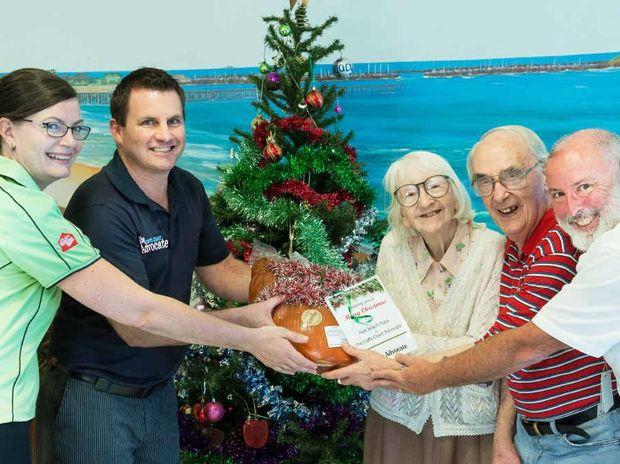 HAPPY CHRISTMAS: Caroline Bleechmore, David Box, Irene Bamber, Ted Hibell and Shaun Bergquist at the handover of the smoked hams to local nursing homes.
