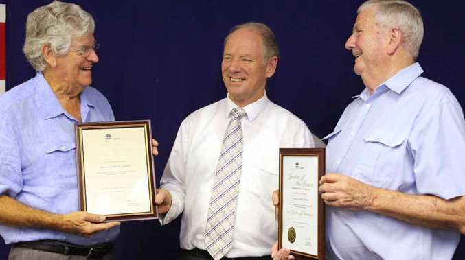 LONG SERVICE: Neville Hillenberg and Jim Cross are congratulated by Andrew Fraser. Photo: Gemima Harvey
