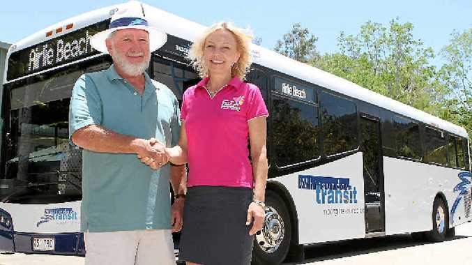 TO THE RESCUE: Whitsunday Transit owner Colin Crossley and Whitsunday Reef Festival chairwoman Margie Murphy shaking hands on the deal that will see Airlie's 9pm New Year's Eve fireworks go ahead for the next two years.