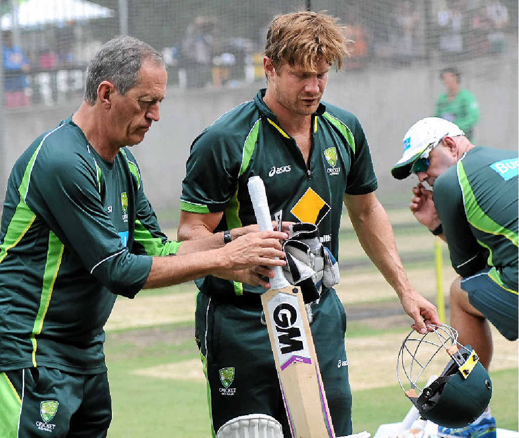 SHAKEN: Australian cricket team doctor Peter Brukner (left) helps Shane Watson as he leaves the nets as coach Darren Lehmann (right) looks on at the MCG. Watson was moments earlier struck by a James Pattinson delivery.