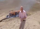 Video: journo shows perils of reporting near burning heroin