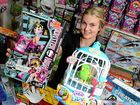 FUN: Paityn Montague of Mr Toys Toyworld Kawana with some of the popular toys people are buying for kids this Christmas.