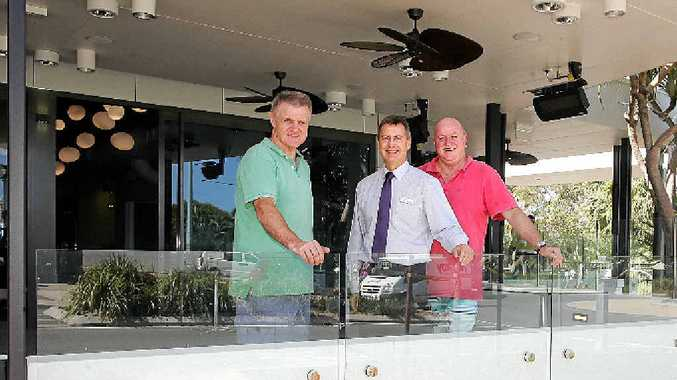 TRANSFORMATION: New Coolum Beach Hotel manager Tony Murray, councillor Stephen Robinson and former manager Gary Bray are excited about next week's opening.
