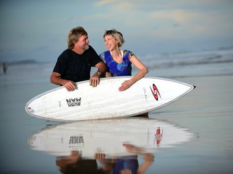 Elisabeth Auffenberg and Adam Smith, pictured at Peregian Beach with the surf board that helped to save their lives, were both survivors of the 2004 Boxing Day tsunami. Photo: Iain Curry / Sunshine Coast Daily