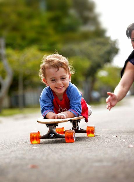 Finn Smith gets a skateboard for his 2nd birthday. Photo: Warren Lynam / Sunshine Coast Daily
