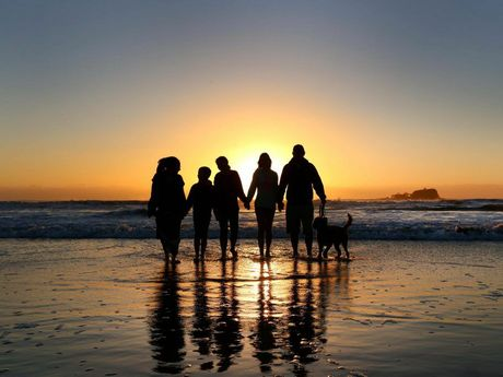 The Young family watch the sunrise over Old Woman Island at Mudjimba Beach on 29th August 2014. Photo: Nicola Brander / Sunshine Coast Daily