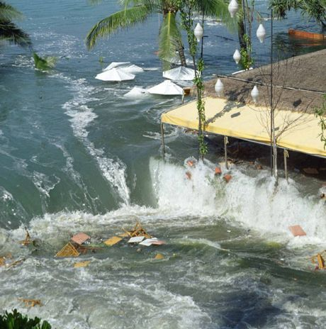 AWASH: The tsunami wave inundates a resort at Patong Beach, Phuket.
