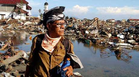 SURVIVOR: A man surveys the remains of his Banda Aceh neighbourhood.