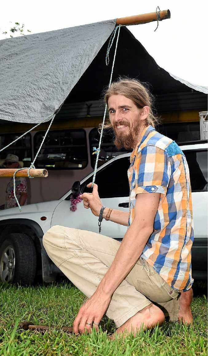 KEEN FAN: Ira Hodgkins, from Kiel Mountain, puts the finishing touches on the campsite at Woodford Folk Festival.