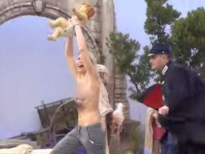 Holy Femen! Topless feminist grabs baby Jesus statue