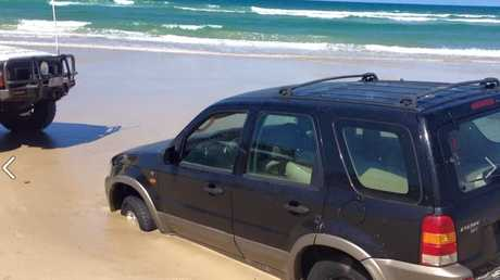 Claytons towing rescue a car from the beach.