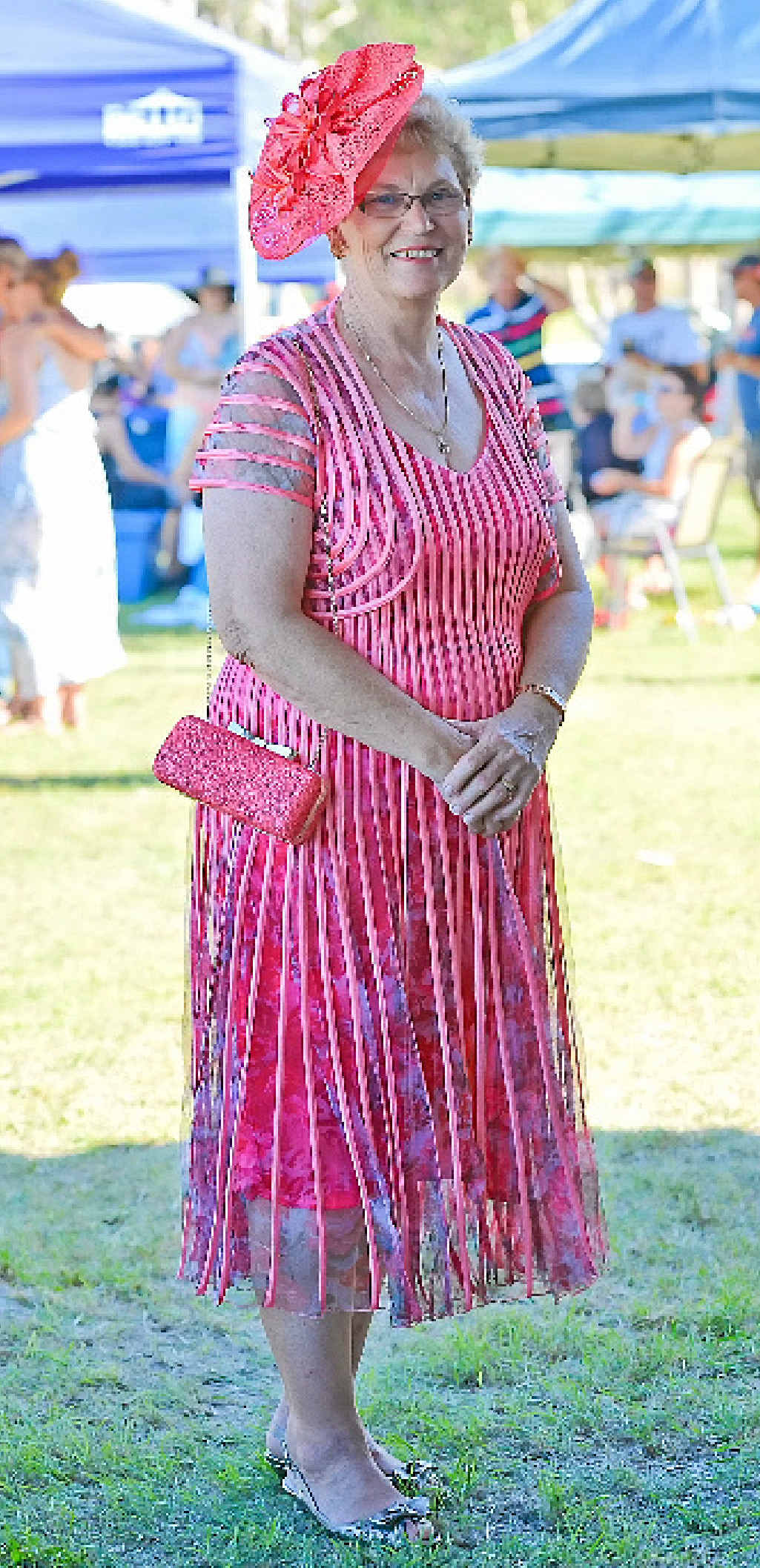 LADY IN RED: Bev Gibbs, from Calliope, won the fashion on the field.